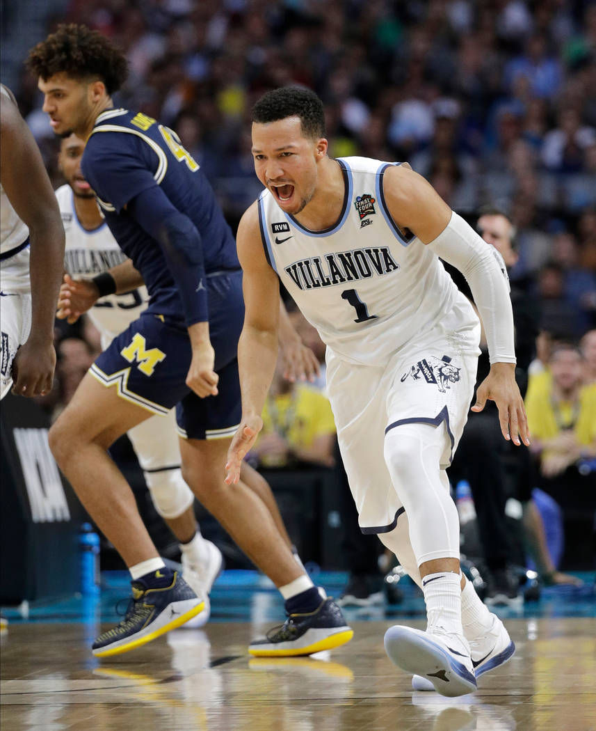Villanova's Jalen Brunson (1) reacts after shooting a basket during the first half in the championship game of the Final Four NCAA college basketball tournament against Michigan, Monday, April 2,  ...