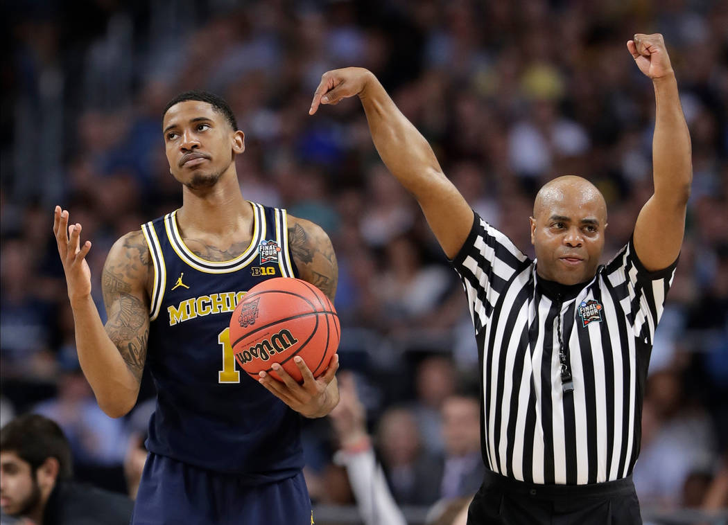 Michigan's Charles Matthews (1) reacts to a foul call during the second half in the championship game of the Final Four NCAA college basketball tournament against Villanova, Monday, April 2, 2018, ...