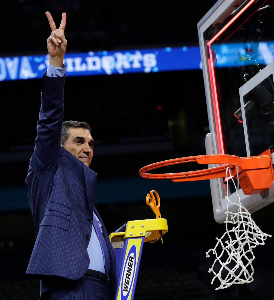 Villanova head coach Jay Wright celebrates after cutting down the net after beating Michigan 79-62 in the championship game of the Final Four NCAA college basketball tournament, Monday, April 2, 2 ...