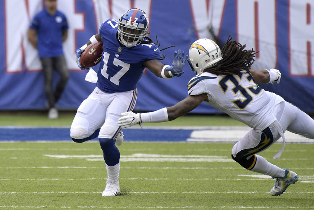 New York Giants wide receiver Dwayne Harris (17) attempts to avoid a tackle by Los Angeles Chargers free safety Tre Boston (33) during the first half of an NFL football game, Sunday, Oct. 8, 2017, ...