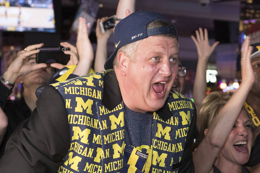 Derek Stevens, CEO and co-owner of The D Las Vegas, reacts while watching his alma mater Michigan take on Loyola in the Final Four Saturday, March 31, 2018, at The D. (Sam Morris/Las Vegas News Bu ...