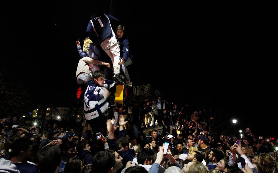 Fans cheer on the campus of Villanova University after the NCAA college basketball national championship game between Villanova and Michigan, Monday, April 2, 2018, in Villanova, Pa. Villanova won ...