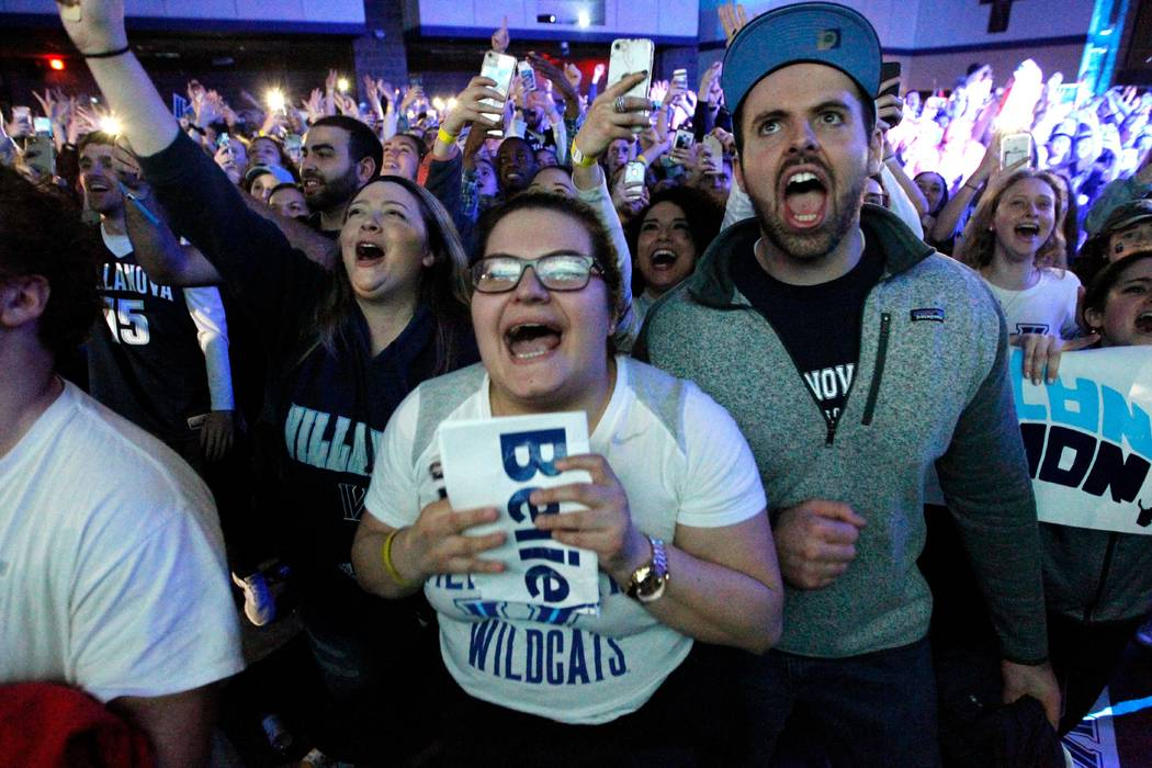 Fans cheer on the campus of Villanova University after of the national NCAA college basketball championship between Villanova and Michigan, Monday, April 2, 2018, in Villanova, Pa. Villanova won 7 ...