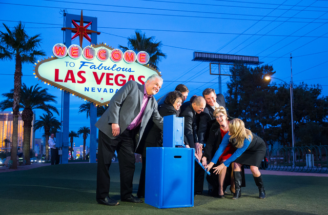 Clark County Commissioner Steve Sisolak, left, Clark County Commissioner Mary Beth Scow, Matt Van Note with Bombard Renewable Energy, President and CEO of Consumer Electronics Association Gary Sha ...