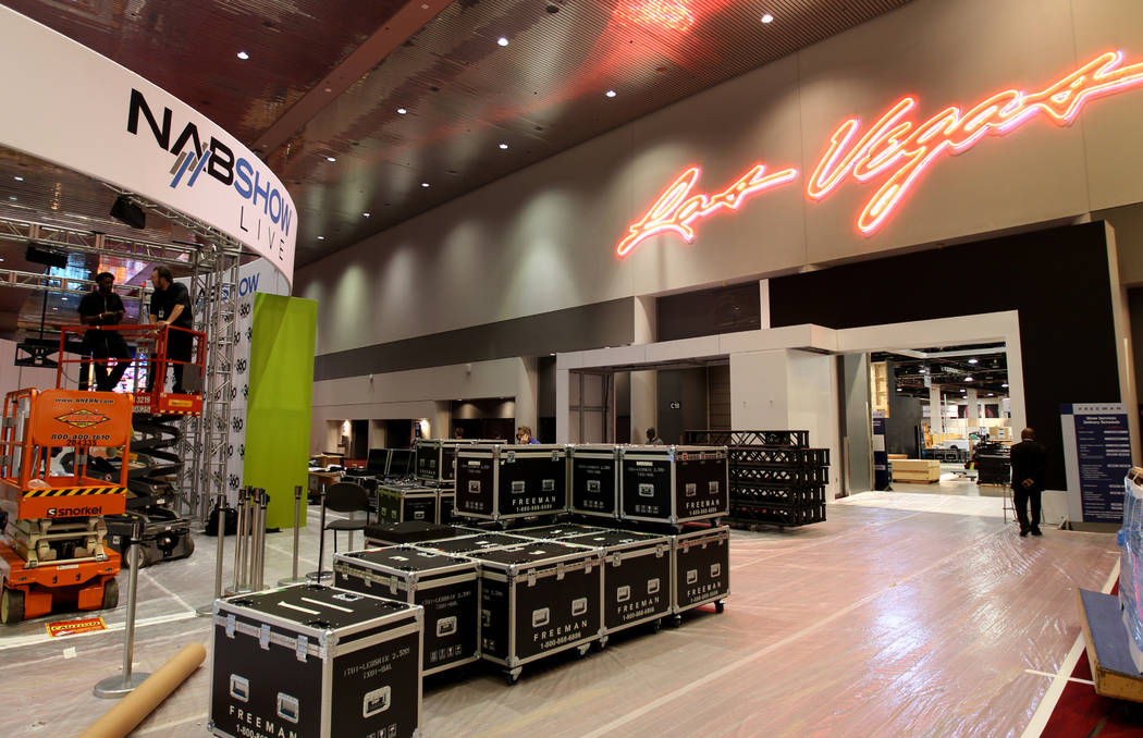 Workers prepare for the upcoming National Association of Broadcasters Show at the Las Vegas Convention Center, Tuesday, April 3, 2018. The NAB trade show starts April 7, with exhibits April 9-12.  ...
