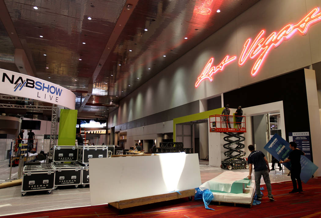 Workers set up for the upcoming National Association of Broadcasters Show at the Las Vegas Convention Center, Tuesday, April 3, 2018. The NAB trade show starts April 7, with exhibits April 9-12. K ...