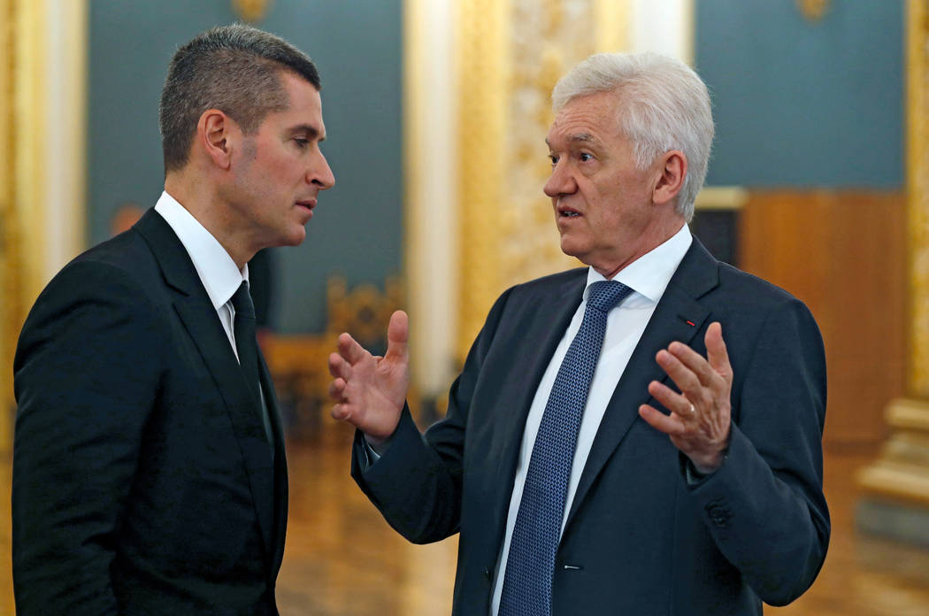 Russian tycoon Gennady Timchenko, right, speaks with Chairman of the Board of Directors of Summa Group, a member of the Board of Trustees of the Bolshoi Theatre, Ziyavudin Magomedov, in the Kremli ...