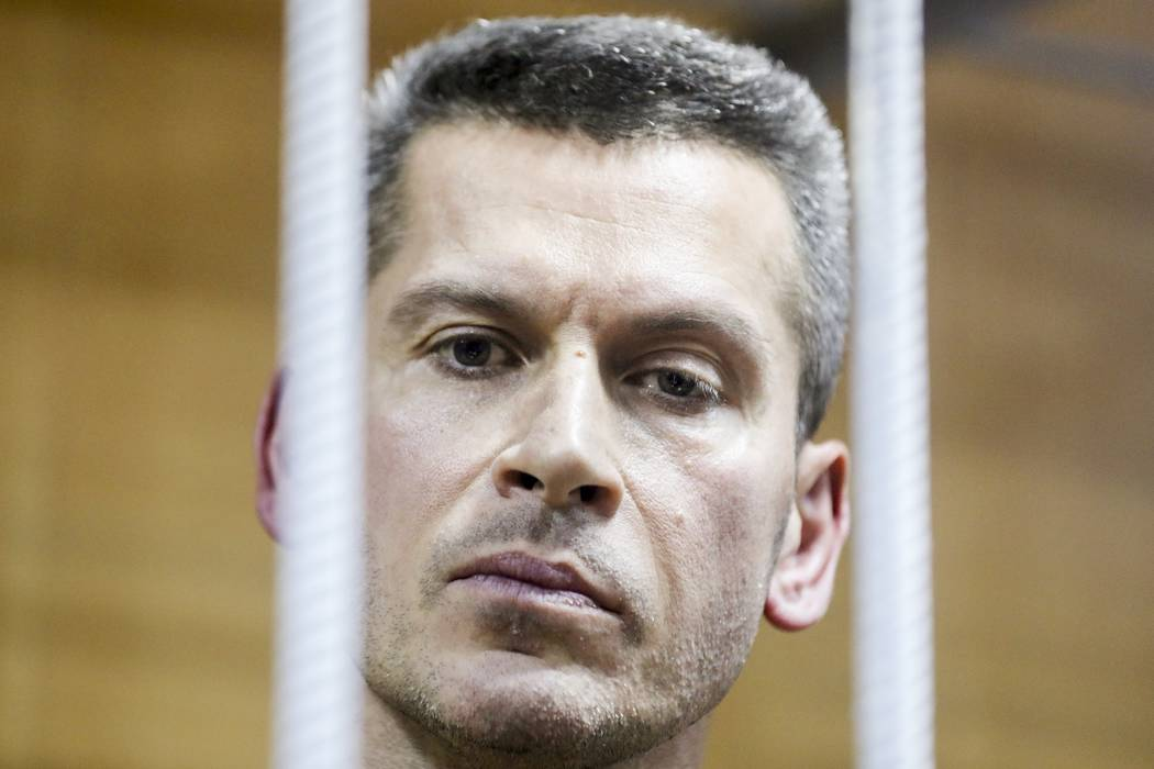 In this photo taken on Saturday, March 31, 2018, Ziyavudin Magomedov, who is worth around dollars US 1.4 billion, according to the Russian Forbes magazine, looks through a cage bars in a court roo ...