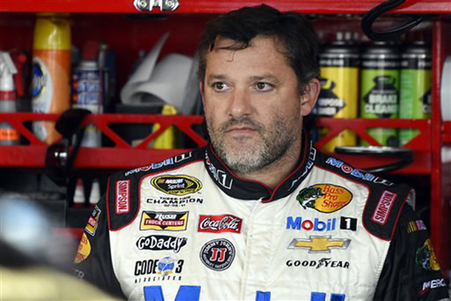 In this Sept. 13, 2014, file photo, Tony Stewart looks out from his garage during practice for the NASCAR Sprint Cup series auto race at Chicagoland Speedway in Joliet, Ill. A grand jury decided a ...