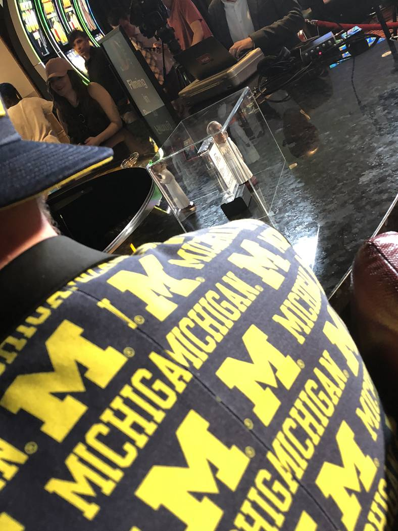 A shot of Derek Stevens, co-owner of The D Las Vegas, with his lucky Pope Francis bobble-head at his side, as he watches Michigan fall to Villanova in the finals of the NCAA Tournament on Monday,  ...