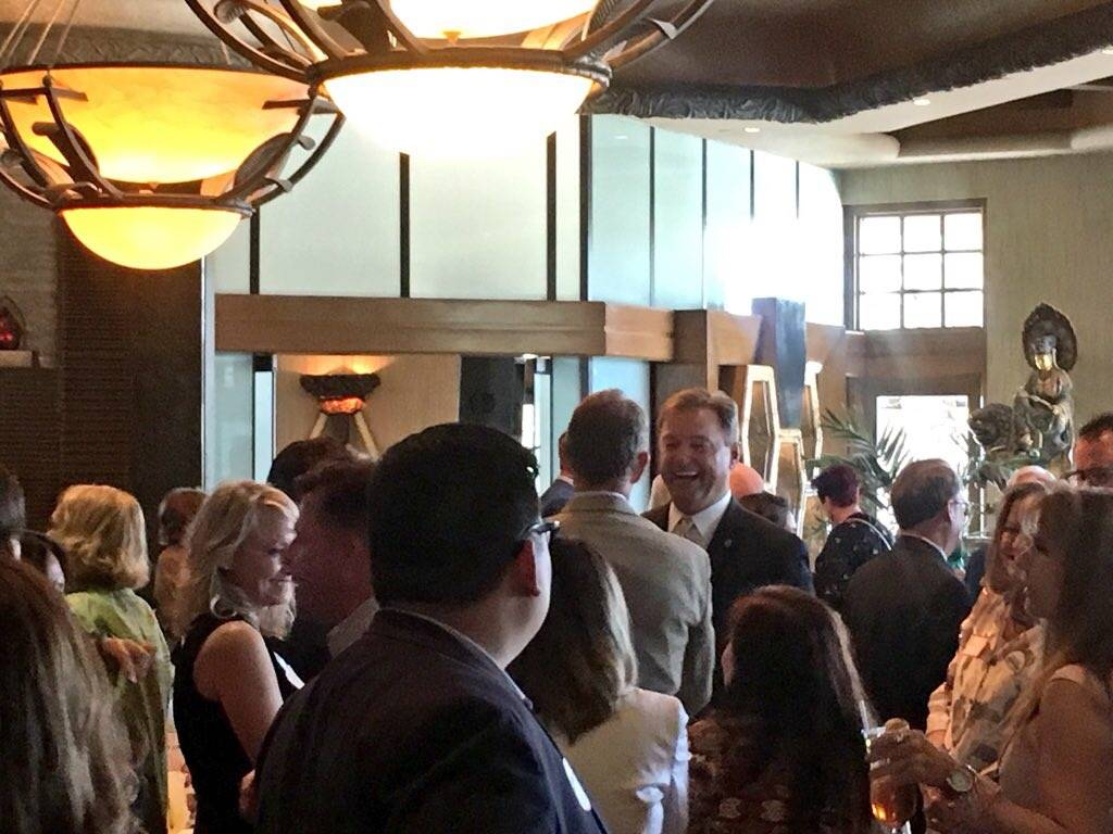 U.S. Senator Dean Heller chats with supporters at the Nevada Republican Men's Club luncheon Tuesday. Media was not allowed inside the venue, some say at the request of the veteran GOP senator. (Ra ...