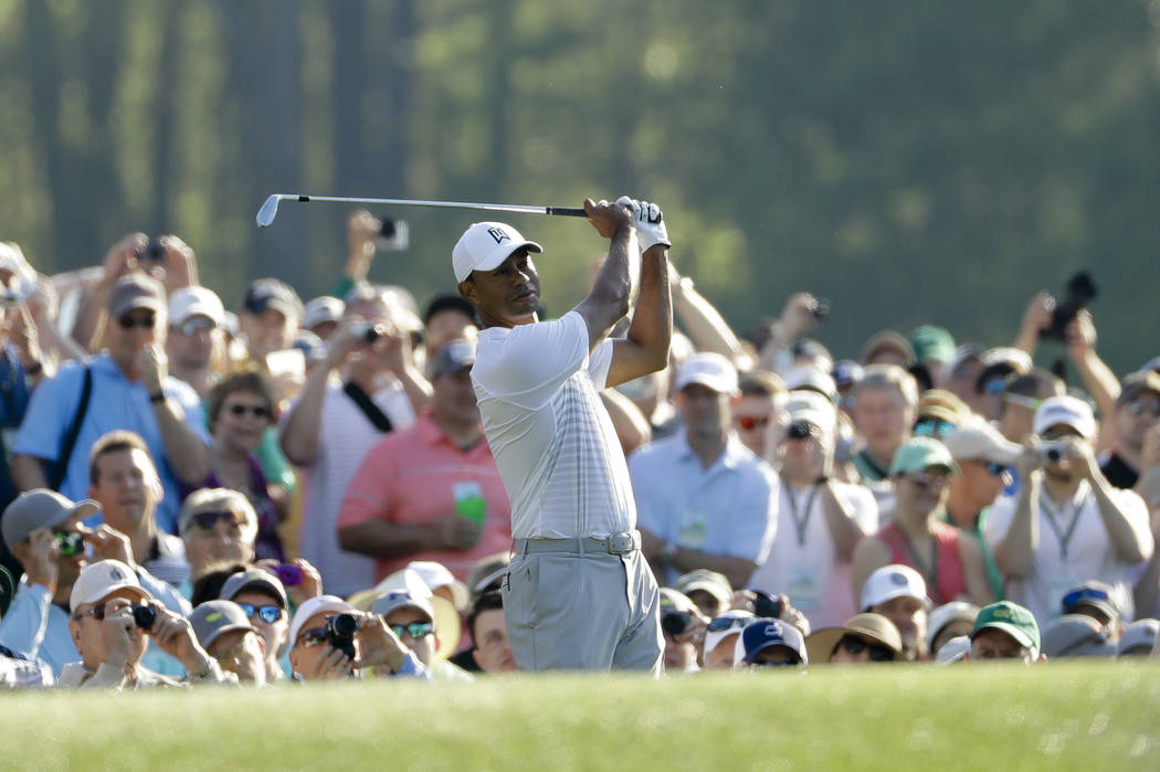 Tiger Woods watches his tee shot on the 12th hole during practice for the Masters golf tournament at Augusta National Golf Club, Tuesday, April 3, 2018, in Augusta, Ga. (AP Photo/Matt Slocum)