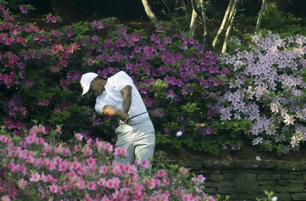 Tiger Woods hits his tee shot on the 13th hole during practice for the Masters golf tournament at Augusta National Golf Club, Tuesday, April 3, 2018, in Augusta, Ga. (AP Photo/Matt Slocum)