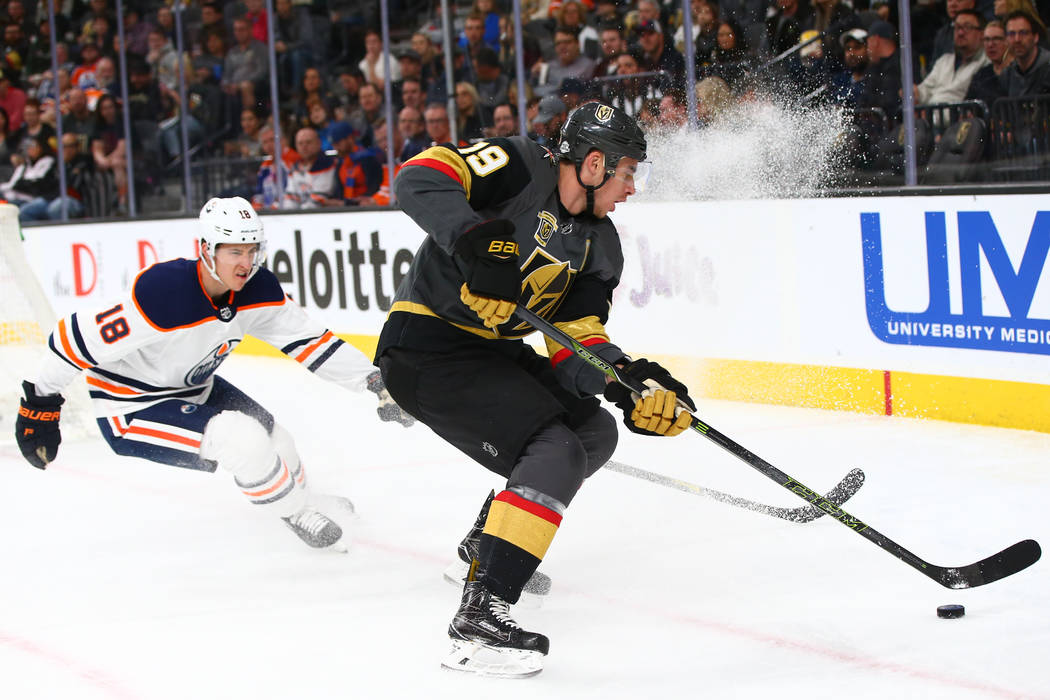 Golden Knights right wing Reilly Smith (19) controls the puck against  Edmonton Oilers center 90a552b45af4