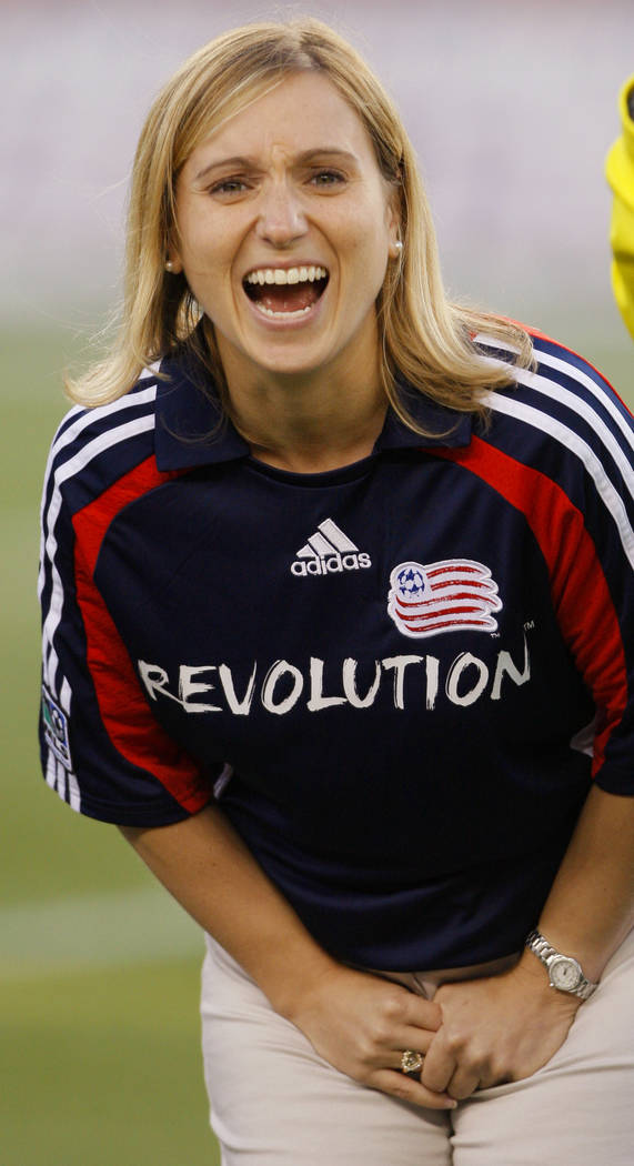 Kerri Strug, 1996  USA Olympic gold medal gymnast, laughs before tossing the coin at the start the New England Revolution MLS soccer match against the Chicago Fire in Foxborough, Mass., Saturday n ...