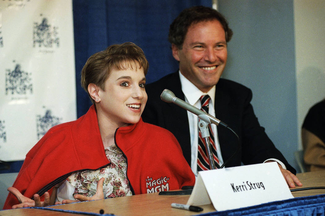 Kerri Strug of the 1996 Olympic Gold Medal-winning U.S. gymnastics team speaks at a news conference on Thursday, Sept. 12, 1996 in Los Angeles to announce her participation in The Magic of MGM, an ...