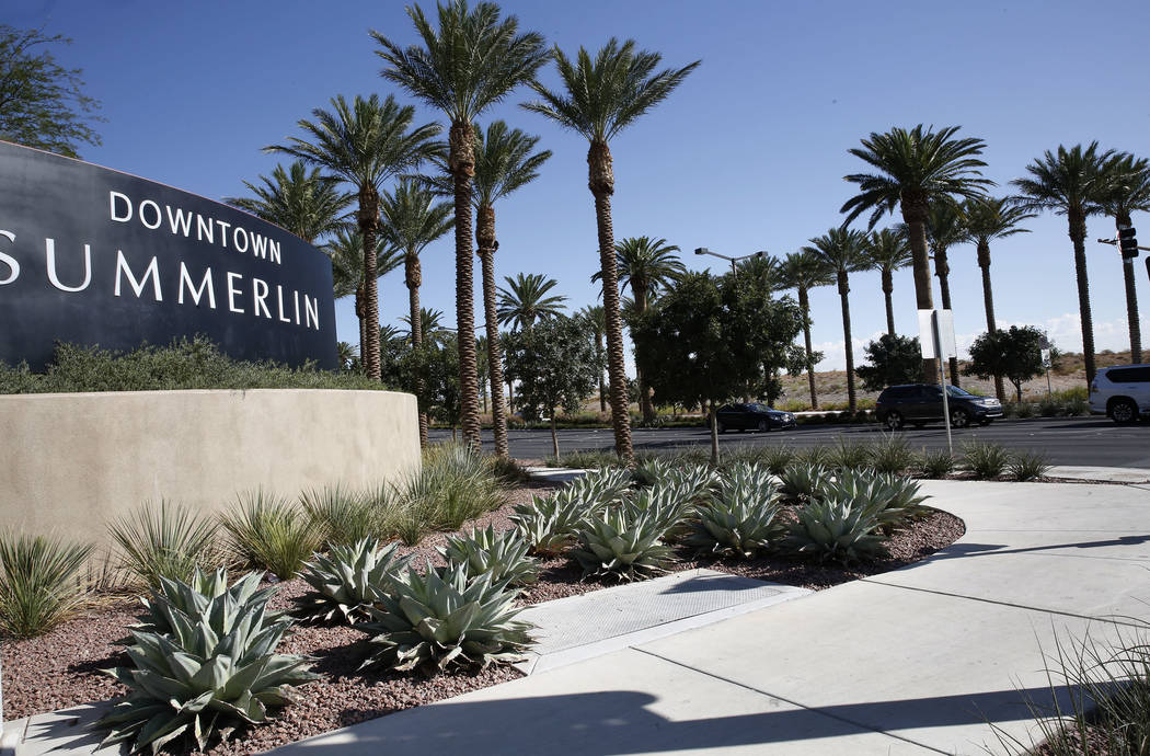 A vacant lot, right, photographed on Thursday, Sept. 14, 2017, where Summerlin developer Howard Hughes Corp. plans to build a 267-unit apartment complex on Sahara Avenue next to Downtown Summerlin ...