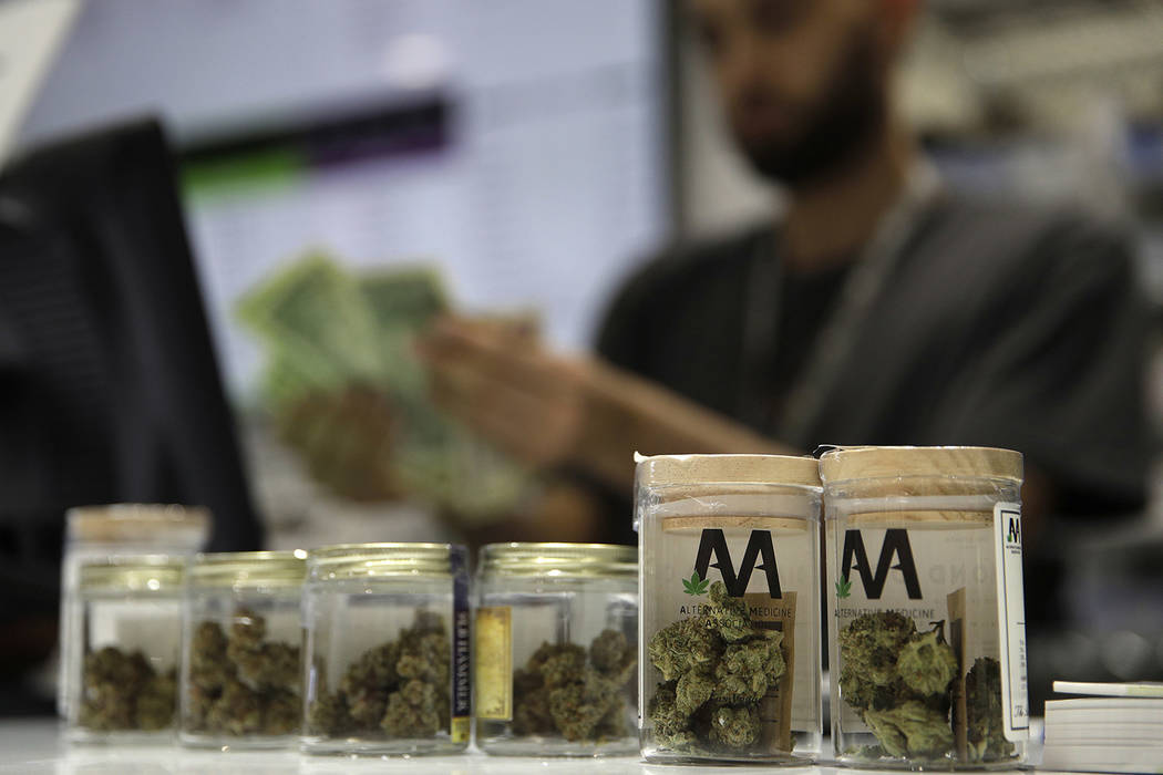 A cashier rings up a marijuana sale at the Essence cannabis dispensary in Las Vegas in July 2017. (AP Photo/John Locher)