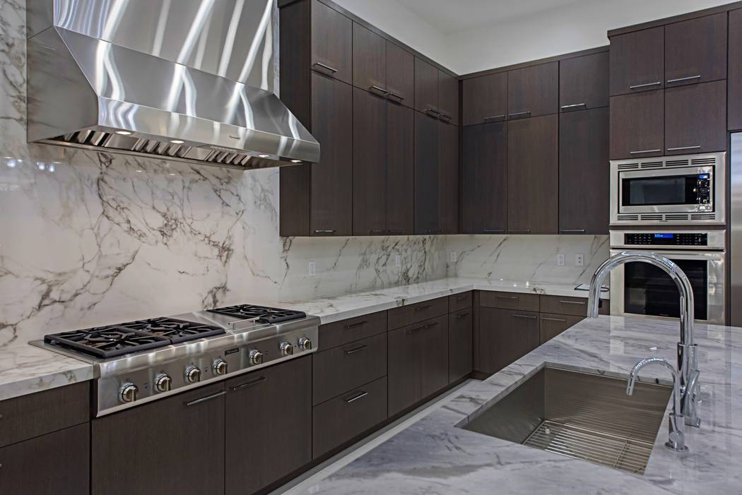 The large kitchen has upgraded appliances. (Canyon Creek Custom Homes)