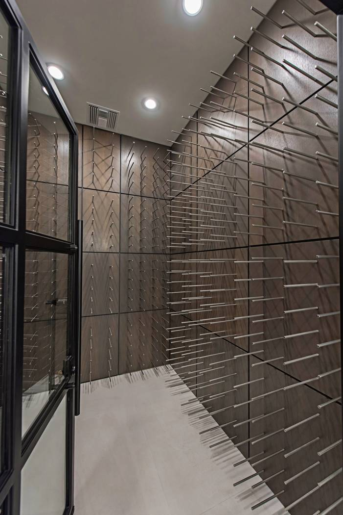 The wine room has stainless-steel pegs and can hold 750 bottles. (Canyon Creek Custom Homes)