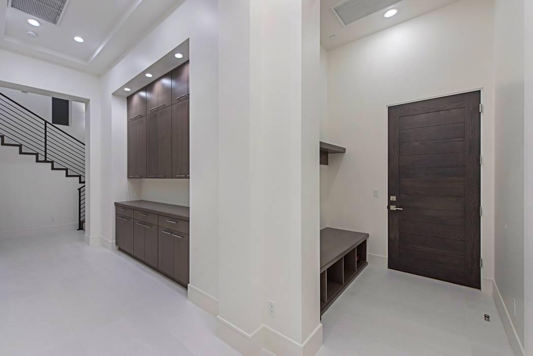 The home has custom cabinets.  (Canyon Creek Custom Homes)