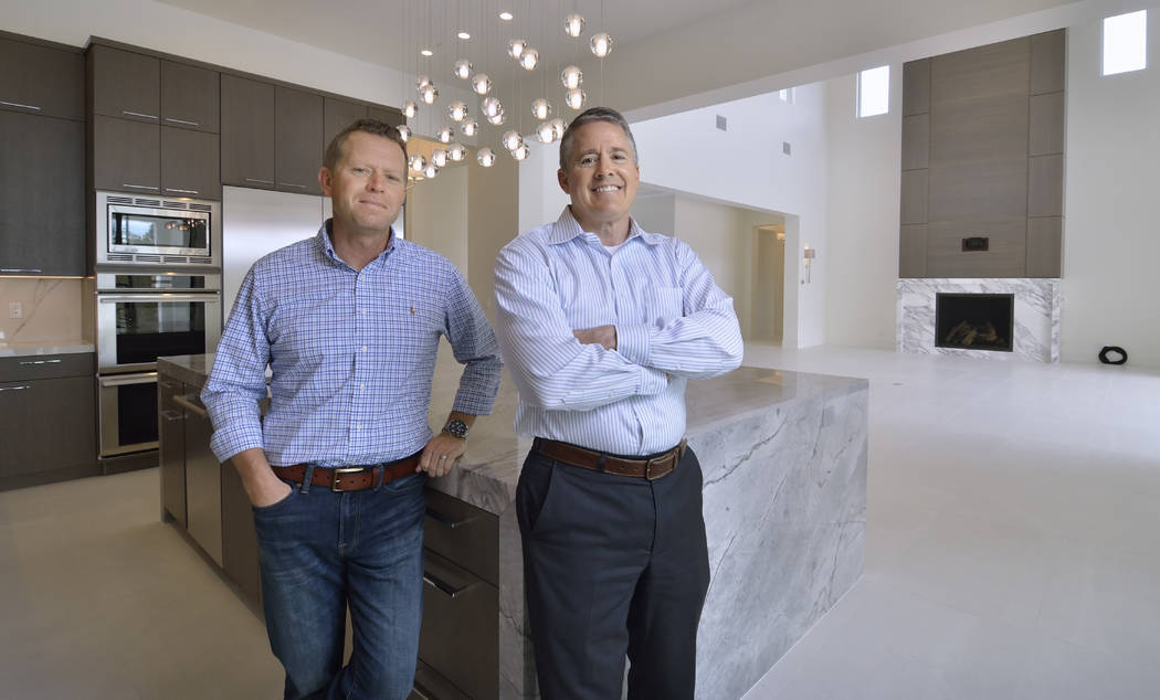 From left, Mitch McClellan, president and broker of Southern Highlands Realty, and John McDonough, owner of Canyon Creek Custom Homes, prepare to show off their custom spec home in Southern Highla ...