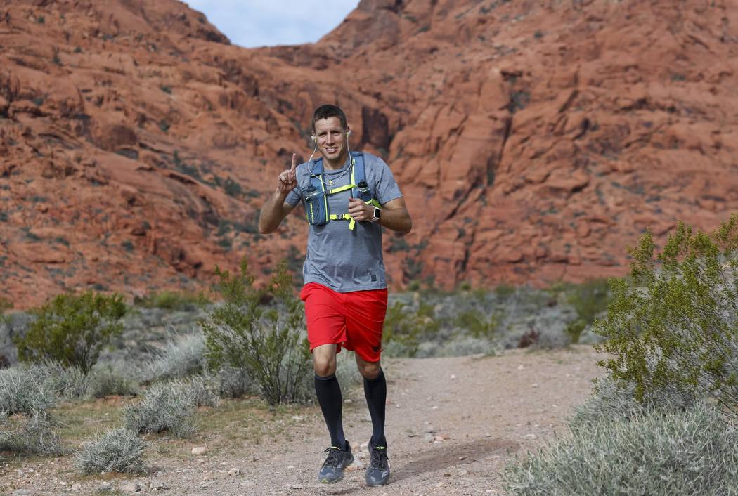Dr. David Ludlow, 38, runs the Kraft Mountain loop trail in the La Madre Mountain Wilderness Area, Saturday, April 7, 2018,in preparation for the 2018 Boston Marathon. The La Madre Wilderness Ar ...