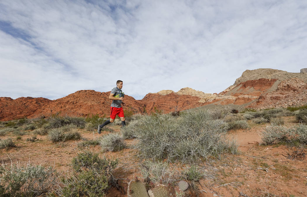 Dr. David Ludlow, 38, runs the Kraft Mountain loop trail in the La Madre Mountain Wilderness Area, Saturday, April 7, 2018, in preparation for the 2018 Boston Marathon. The La Madre Wilderness Are ...