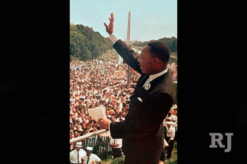 """In this Aug. 28, 1963 file photo, the Rev. Dr. Martin Luther King, Jr. acknowledges the crowd at the Lincoln Memorial for his """"I Have a Dream"""" speech during the March on Washington. (AP)"""