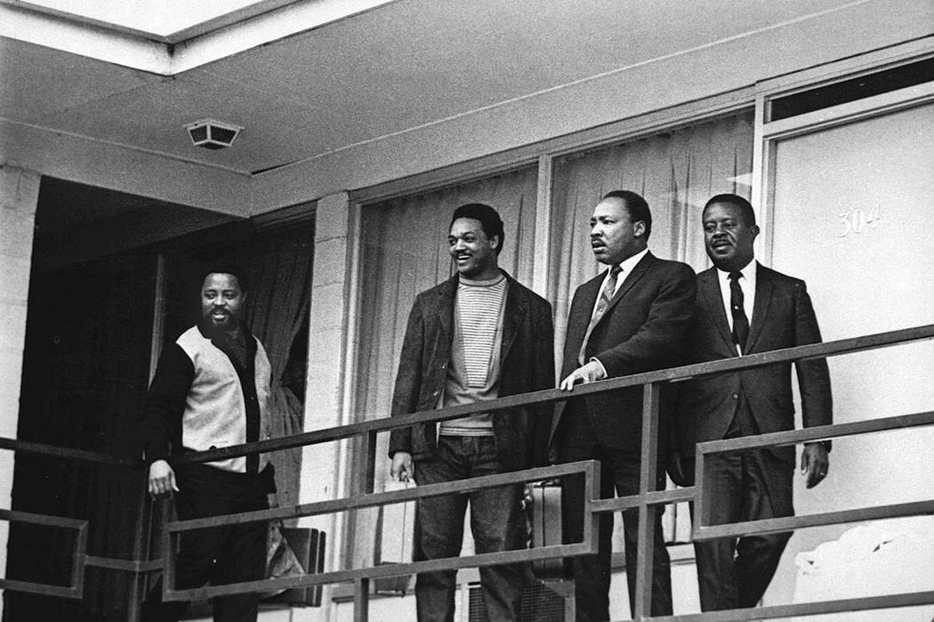 In this April 3, 1968 file photo, the Rev. Martin Luther King Jr. stands with other civil rights leaders on the balcony of the Lorraine Motel in Memphis, Tenn., a day before he was assassinated at ...