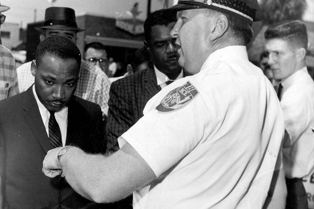 In this July 27, 1962 file photo, the Rev. Dr. Martin Luther King, Jr., is arrested by Albany's Chief of Police Laurie Pritchett after praying at City Hall in Albany, Ga. King participated in a mo ...