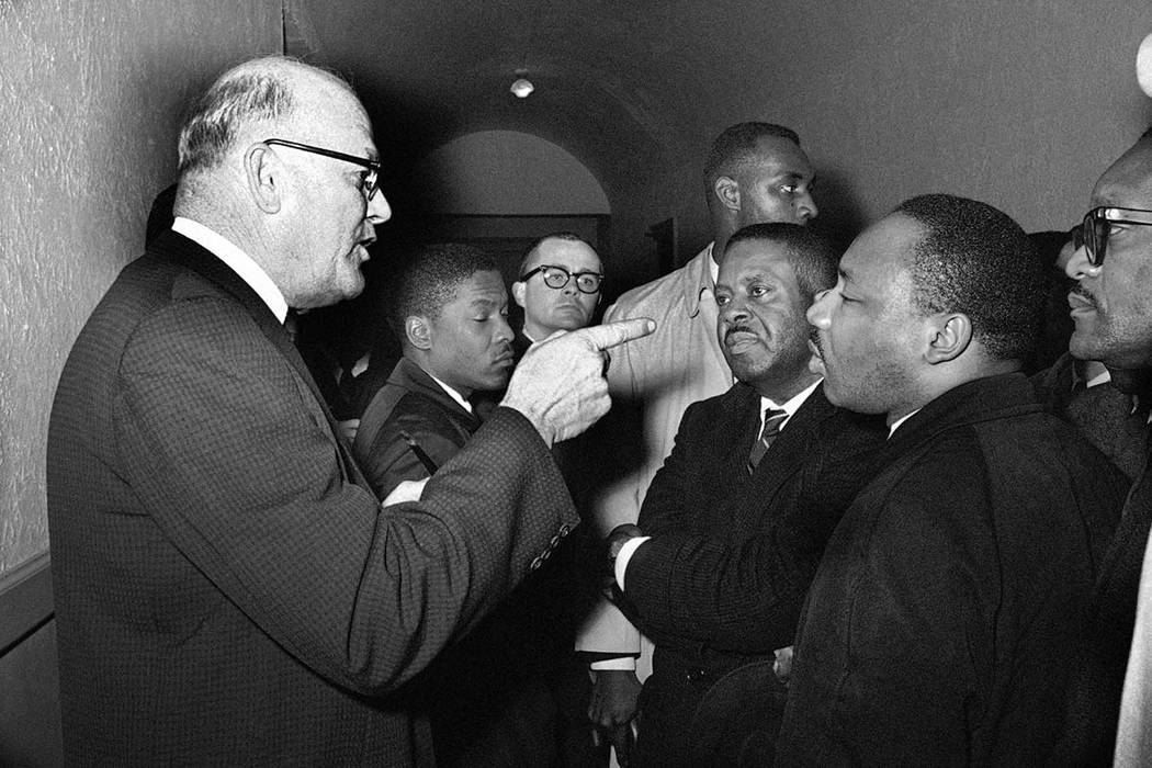 In this March 1, 1965 file photo, registrar Carl Golson shakes a finger at the Rev. Dr. Martin Luther King Jr. during meeting at the courthouse in Hayneyville, Ala. King inquired about voter regis ...