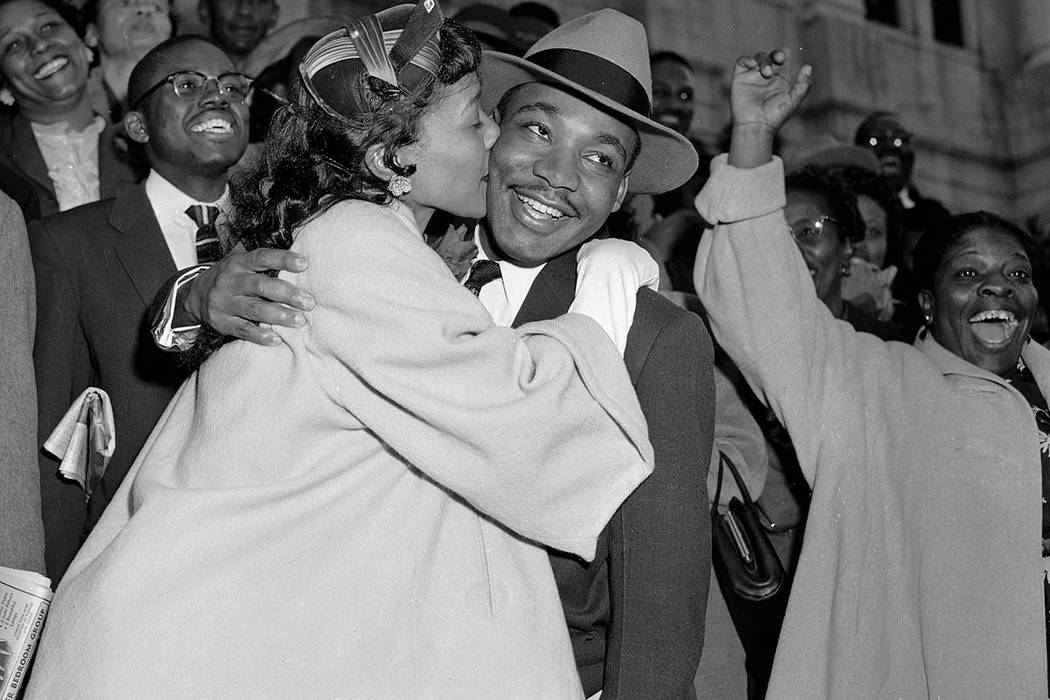 In this March 22, 1956, file photo, the Rev. Martin Luther King Jr. is welcomed with a kiss by his wife, Coretta, after leaving court in Montgomery, Ala. King was found guilty of conspiracy to boy ...