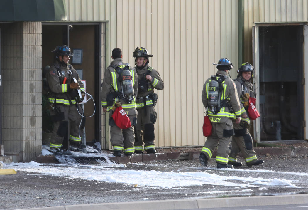 The Clark County and Henderson firefighters investigate the cause of the fire at Sunkist Graphics, 401 E. Sunset Road, near East Sunset Road and Boulder Highway on Wednesday, April 4, 2018, in Hen ...