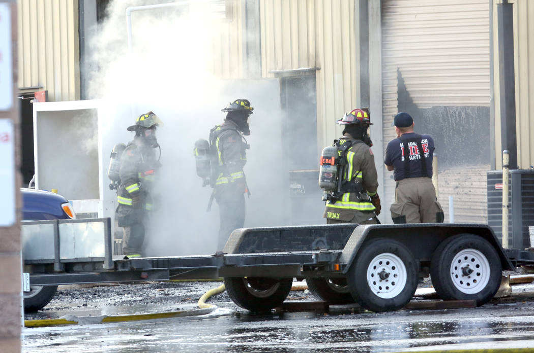 The Clark County and Henderson firefighters battle a fire at Sunkist Graphics, 401 E. Sunset Road, near East Sunset Road and Boulder Highway on Wednesday, April 4, 2018, in Henderson.  (Bizuayehu  ...