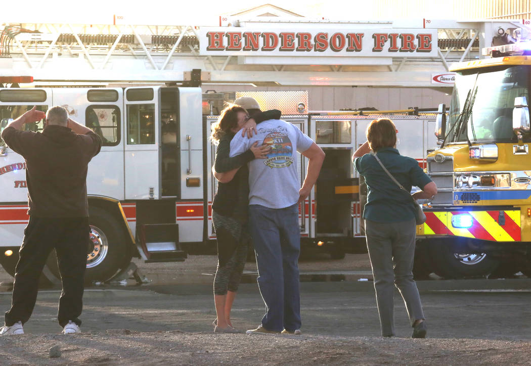Sunkist Graphics employees comfort each other as the Clark County and Henderson firefighters battle a fire at their building at 401 E. Sunset Road, near East Sunset Road and Boulder Highway on Wed ...
