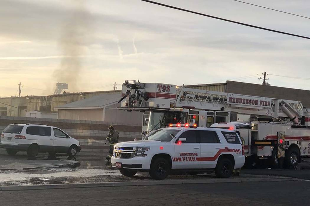 Henderson firefighters work on a blaze at Sunkist Graphics, 401 Sunset Road, Wednesday morning, April 4, 2018. (Bizuayehu Tesfaye/Las Vegas Review-Journal) @bizutesfaye