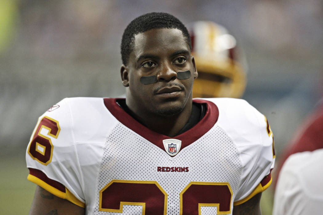 Washington Redskins running back Clinton Portis looks on during the first quarter of an NFL football game against the Detroit Lions, in Detroit.  (AP Photo/Paul Sancya, File)