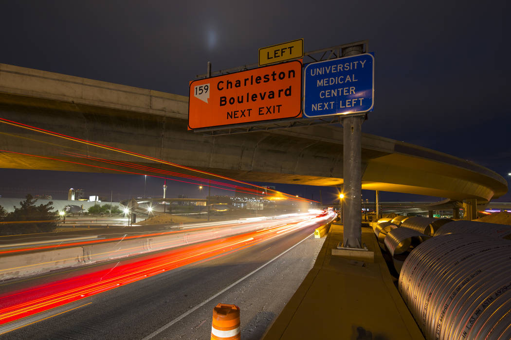 Vehicles travel along southbound lanes of Interstate 15  through the Spaghetti Bowl freeway interchange near downtown Las Vegas on Friday, April 6, 2018. Richard Brian Las Vegas Review-Journal @ve ...