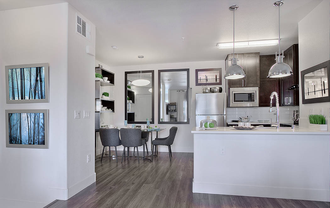 The kitchens have wood laminate flooring, dark wood kitchen cabinetry and quartz countertops. (WestCorp Management Group)
