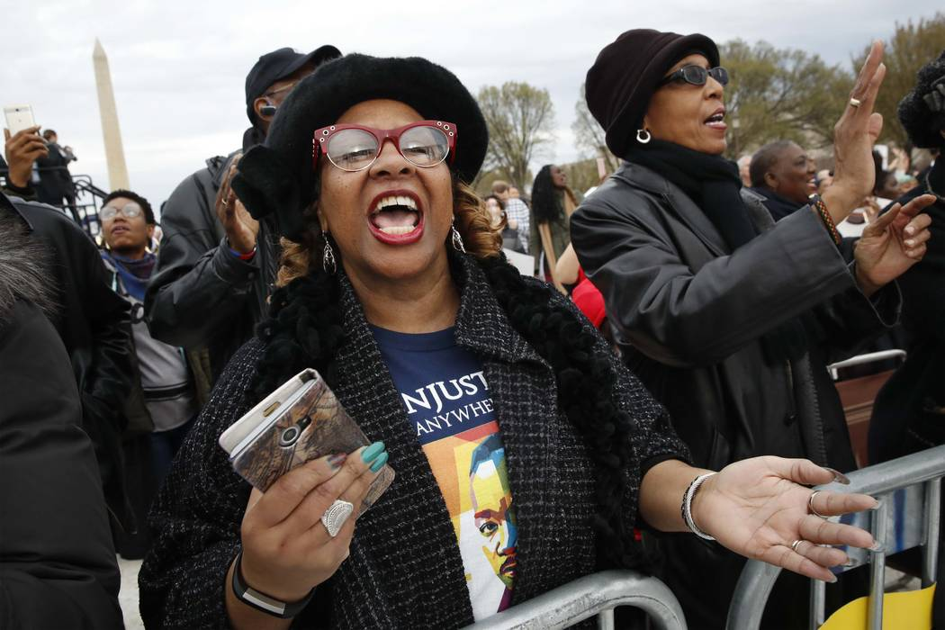 "Wearing a t-shirt of Martin Luther King, Jr., Debra Payne, of Kansas City, Missouri, sings ""This Little Light of Mine,"" next to Jo-Lynn Gilliam, of East Point, Ga., as they attend the A. ..."