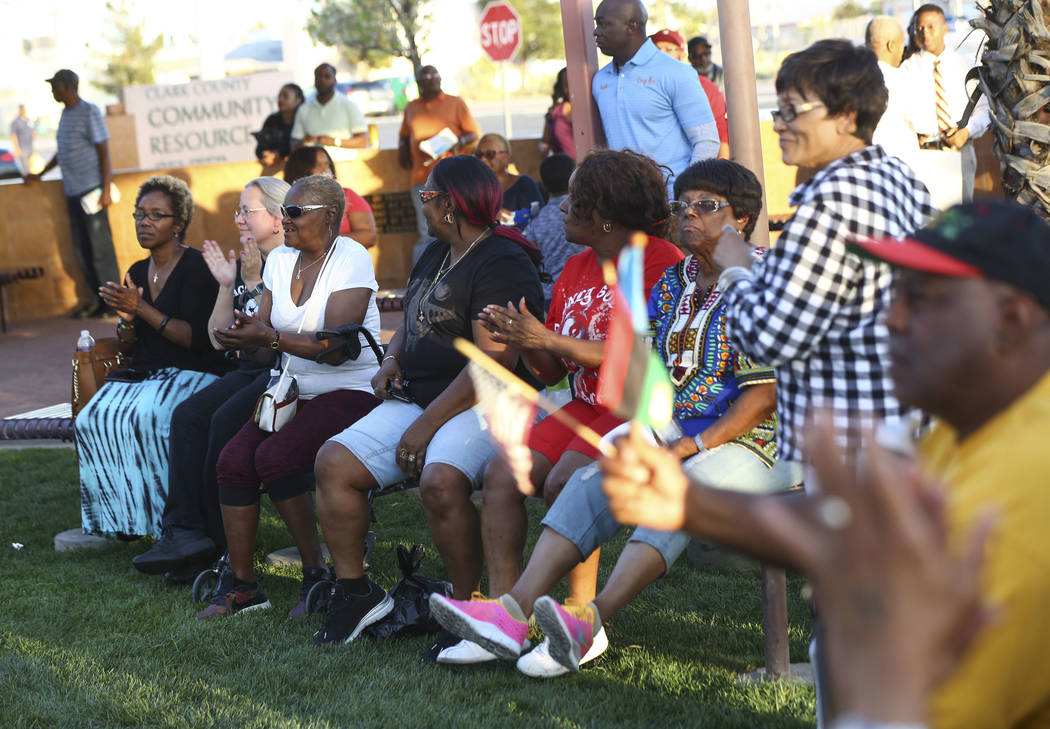 Attendees clap during a vigil held in honor of Dr. Martin Luther King Jr. at the statue made in his memory in North Las Vegas on Wednesday, April 4, 2018. Chase Stevens Las Vegas Review-Journal @c ...