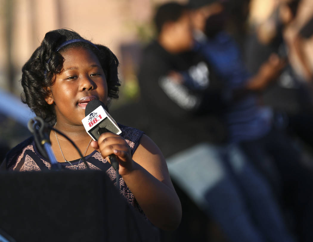 Ten-year-old Alyssa Taylor sings during a vigil held in honor of Dr. Martin Luther King Jr. at the statue made in his memory in North Las Vegas on Wednesday, April 4, 2018. Chase Stevens Las Vegas ...