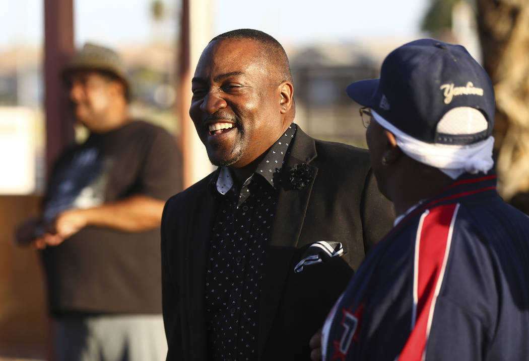 Nevada Assemblyman Tyrone Thompson, D-North Las Vegas, center, during a vigil held in honor of Dr. Martin Luther King Jr. at the statue made in his memory in North Las Vegas on Wednesday, April 4, ...