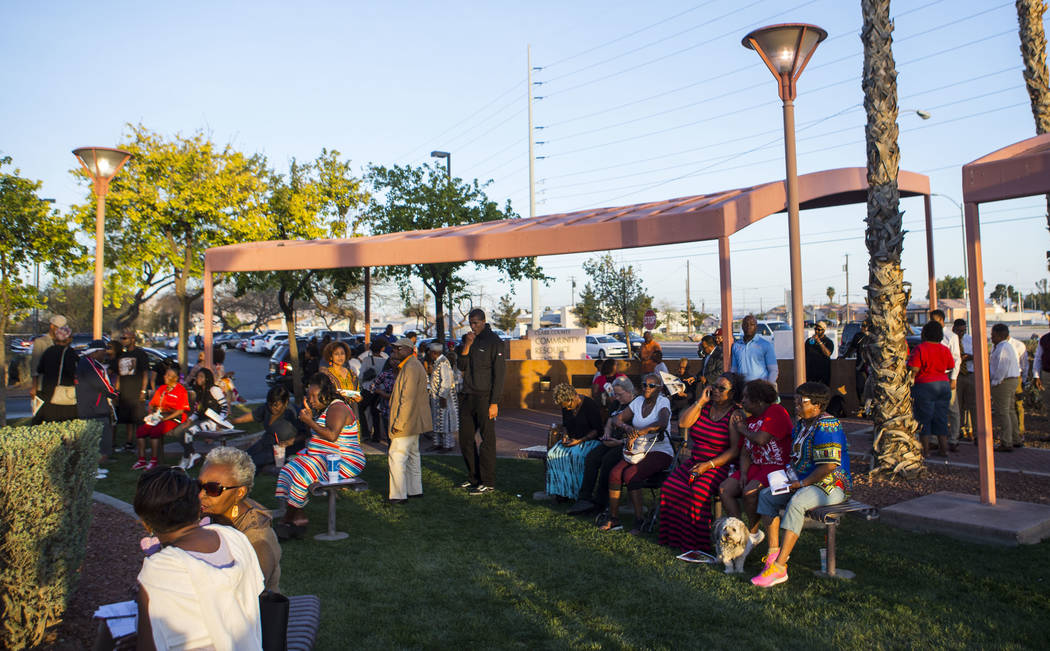 Attendees during a vigil held in honor of Dr. Martin Luther King Jr. at the statue made in his memory in North Las Vegas on Wednesday, April 4, 2018. Chase Stevens Las Vegas Review-Journal @csstev ...