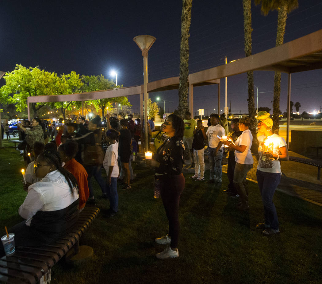 Attendees hold up candles during a vigil held in honor of Dr. Martin Luther King Jr. at the statue made in his memory in North Las Vegas on Wednesday, April 4, 2018. Chase Stevens Las Vegas Review ...