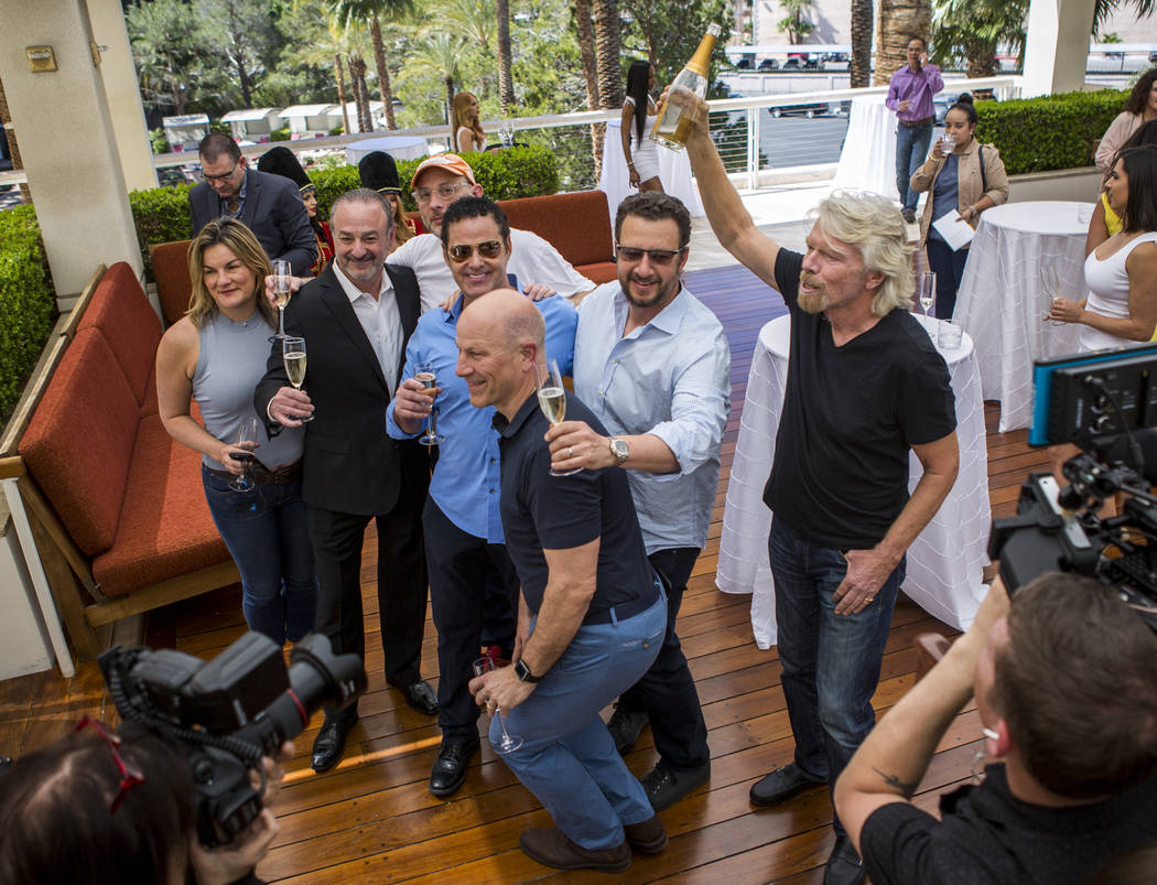 Virgin Group Founder Sir Richard Branson, right, Partner and Property CEO Richard ÒBozÓ Bosworth, second from left, and Virgin Hotels CEO Raul Leal, third from left, take a group photo with othe ...