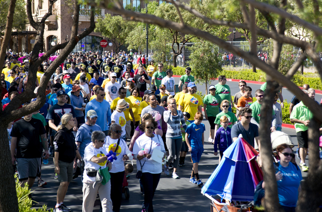 Participants walk during the 26th annual Aid for AIDS of Nevada (AFAN) AIDS Walk Las Vegas at Town Square in Las Vegas on Sunday, April 17, 2016. (Daniel Clark/Las Vegas Review-Journal) Follow @Da ...