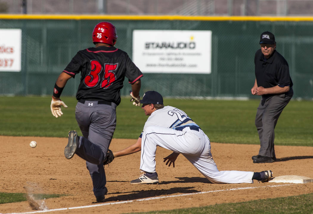 Foothill first baseman Tyler Kara prepares to catch a ball at first base to tag out Las Vegas catcher Daniel Jimenez during the sixth inning at Foothill High School in Henderson on Wednesday, Apri ...