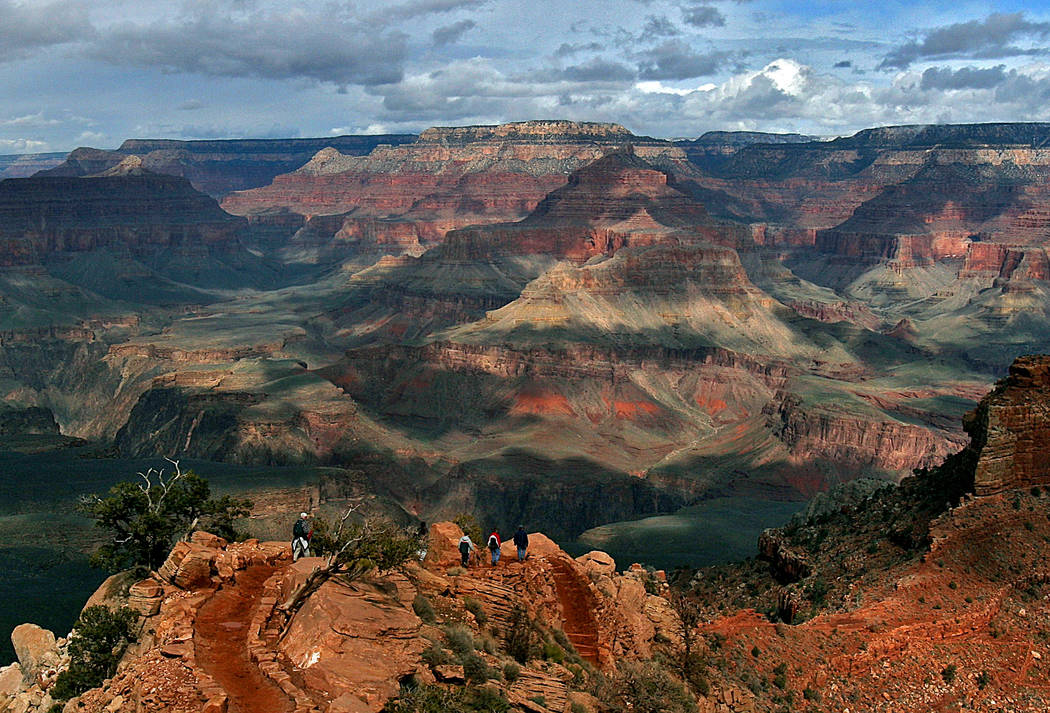 Tourists hike along the South Rim of the Grand Canyon in Grand Canyon, Ariz., in 2005. (AP Photo/Rick Hossman)